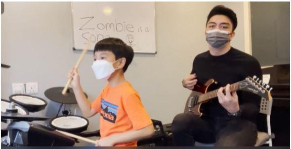 Aynn with his music teacher