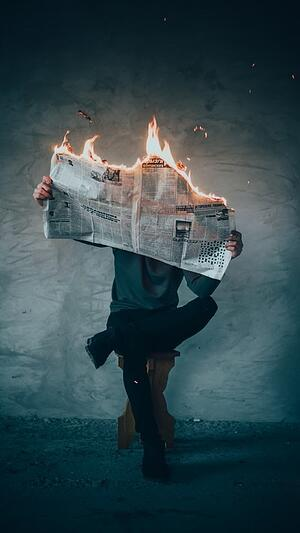 Person reading burning paper