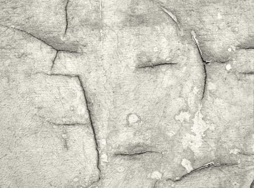 Rock cracks suggesting face