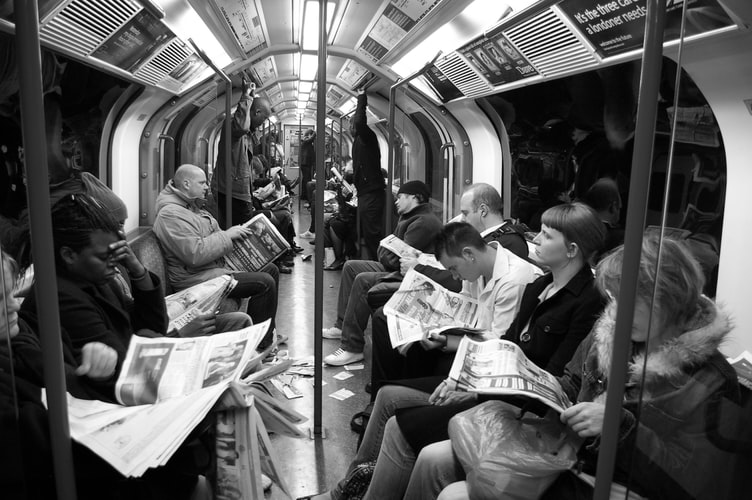 Passengers on the tube in Silence