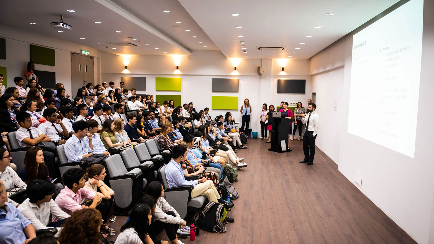 picture of an auditorium of students listening to a lecture